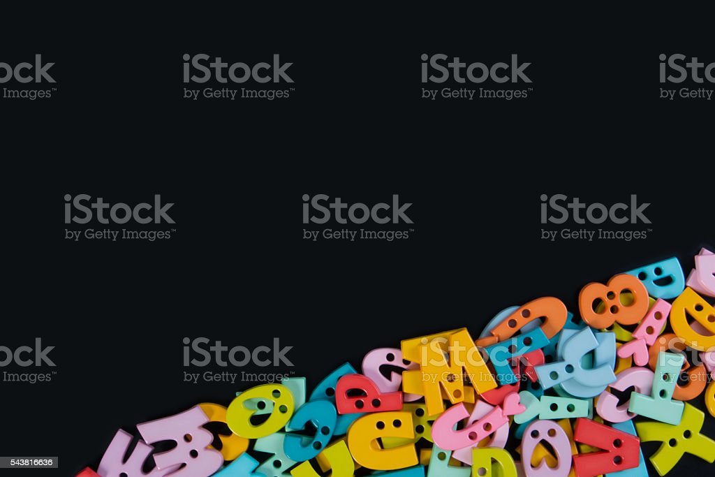 Concept of Education. English alphabet letters on blackboard background. stock photo