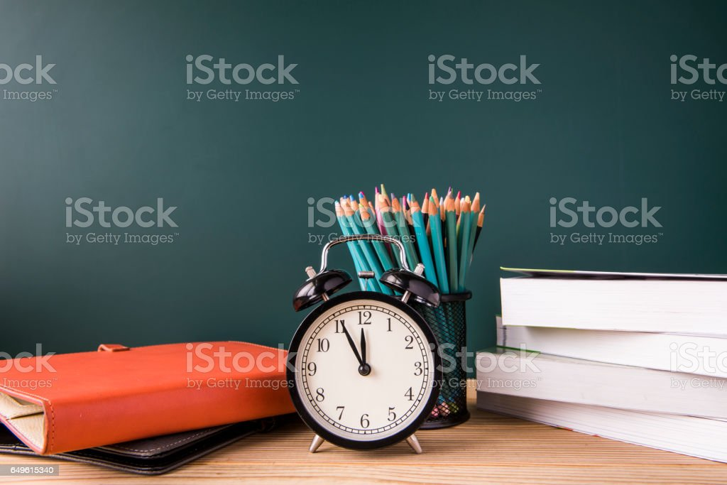 Concept of education or back to school on green background stock photo