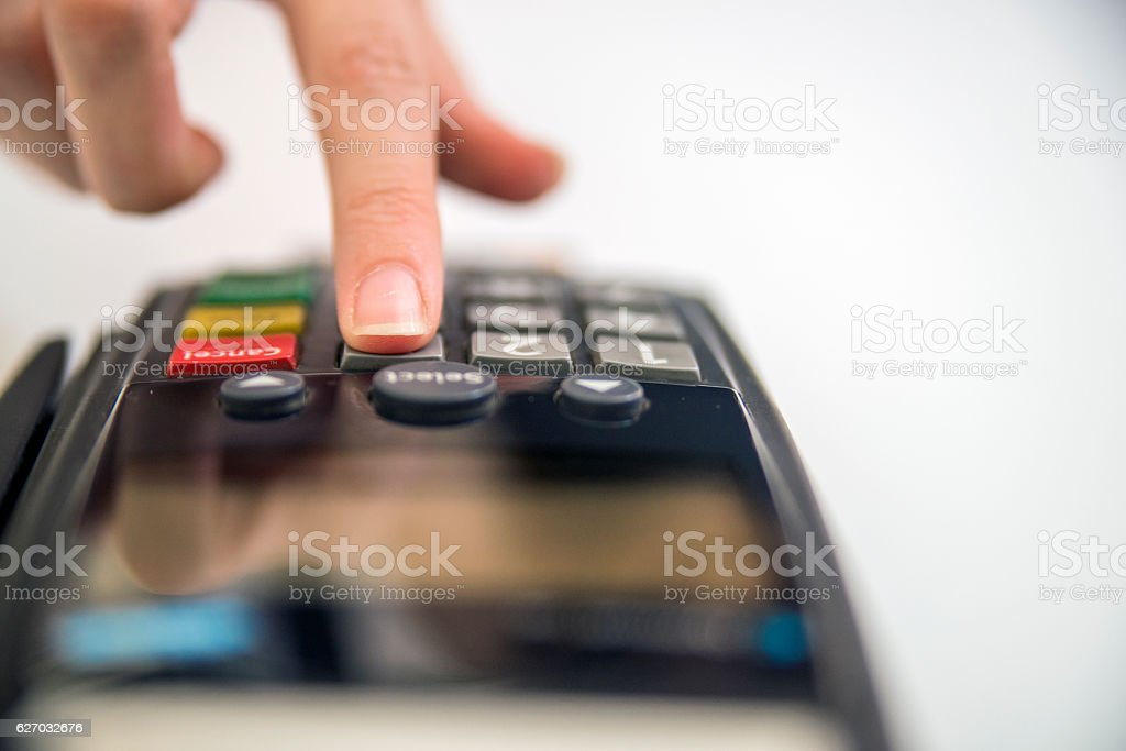 concept  of electronic payment. hand pin code on pin pad stock photo