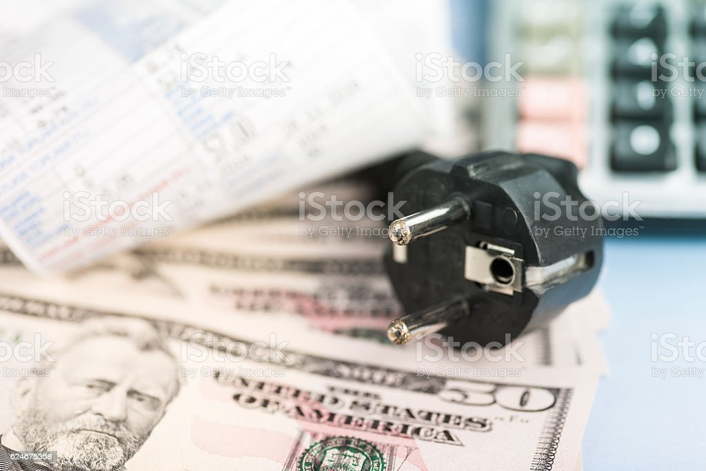 Concept of expensive energy bill and dollar stock photo