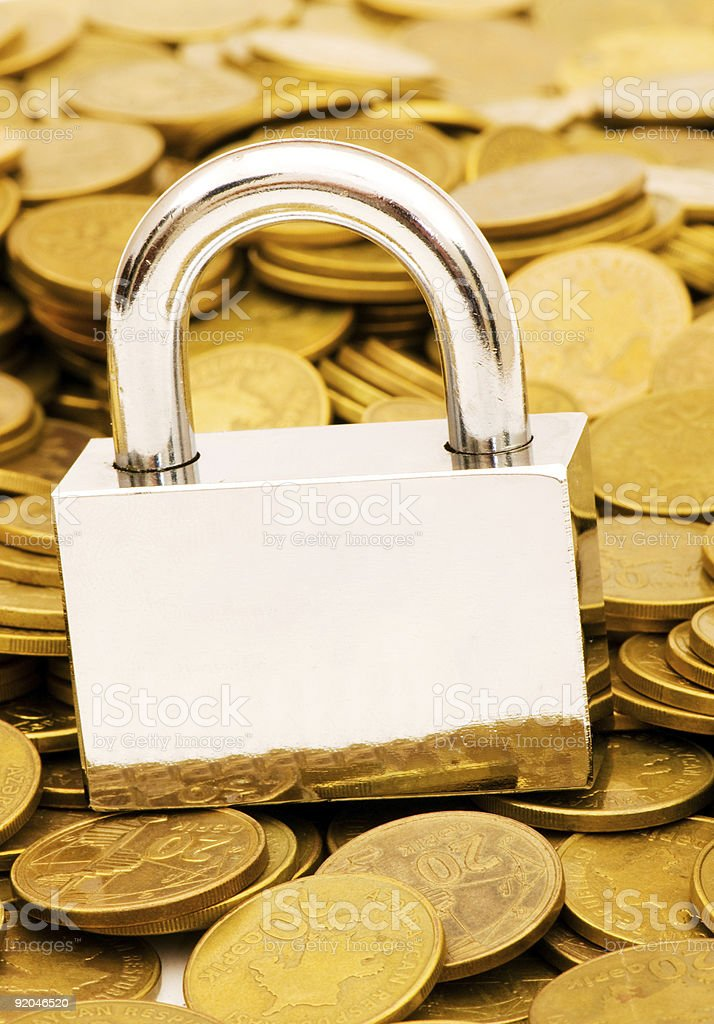 Concept of financial security with lock and coins royalty-free stock photo