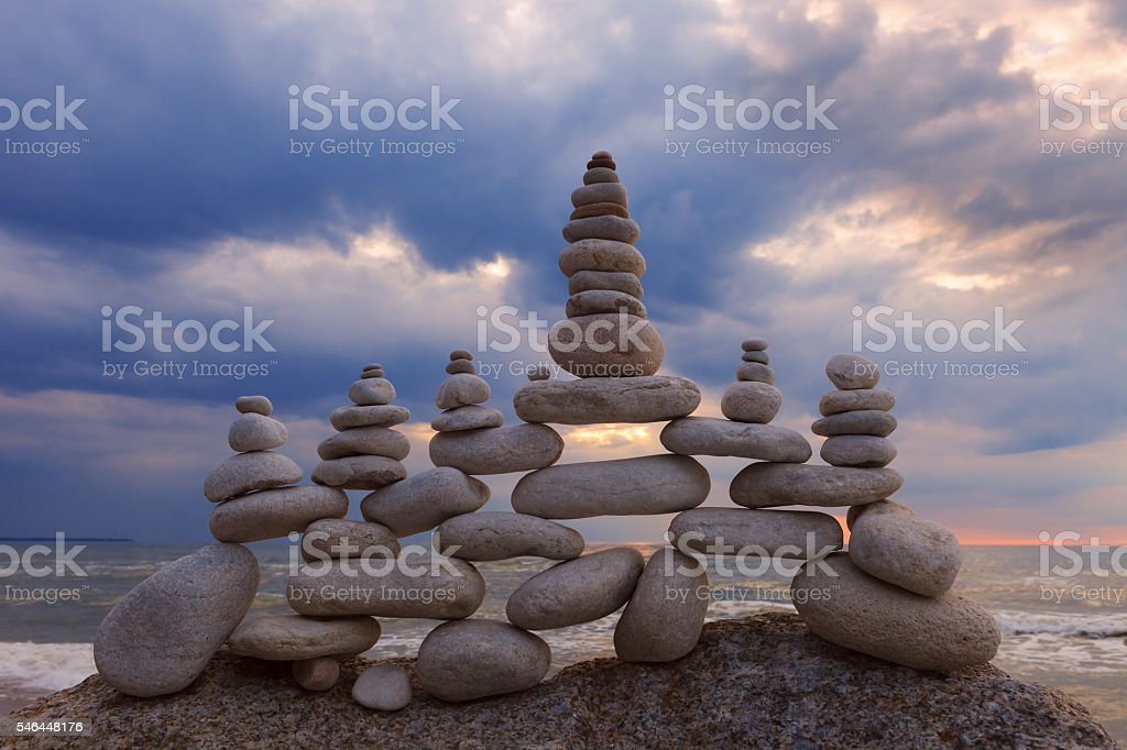 Concept of harmony and balance. Rock Zen at sunset. stock photo