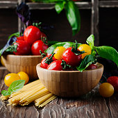 Concept of healthy eating with tomato, pasta and basil