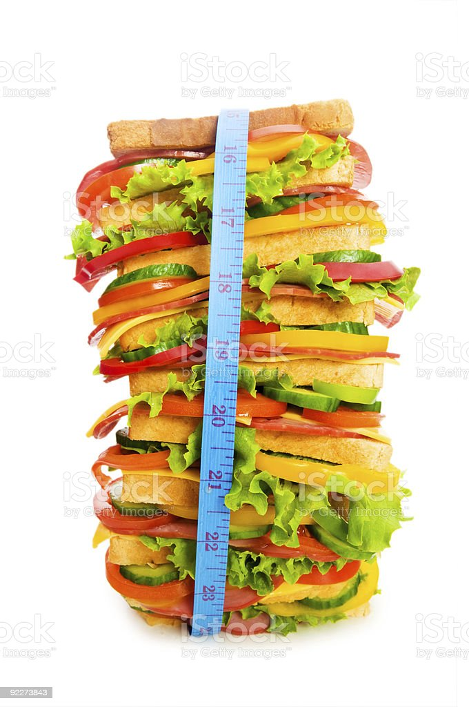 Concept of healthy food with tape measure and sandwich royalty-free stock photo