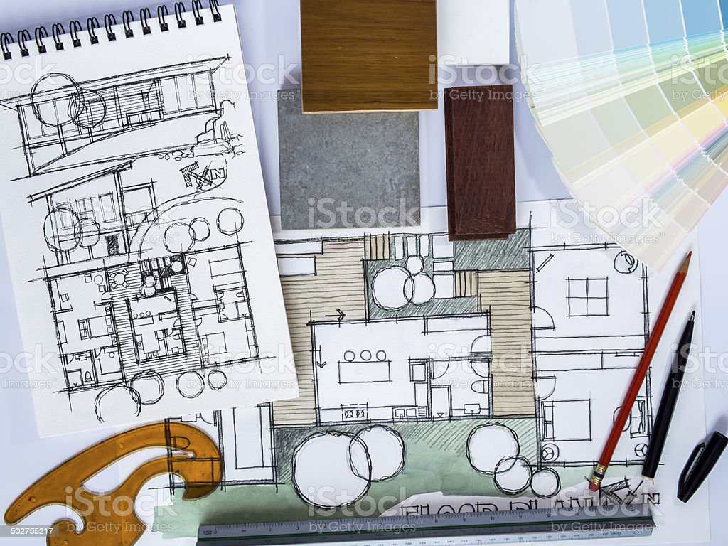 Concept of  home renovation with architecture drawing and material sample stock photo