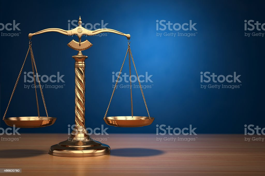 Concept of justice. Law scales on blue background. stock photo