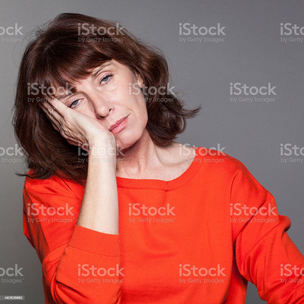 concept of lack of sleep and napping for mature woman stock photo