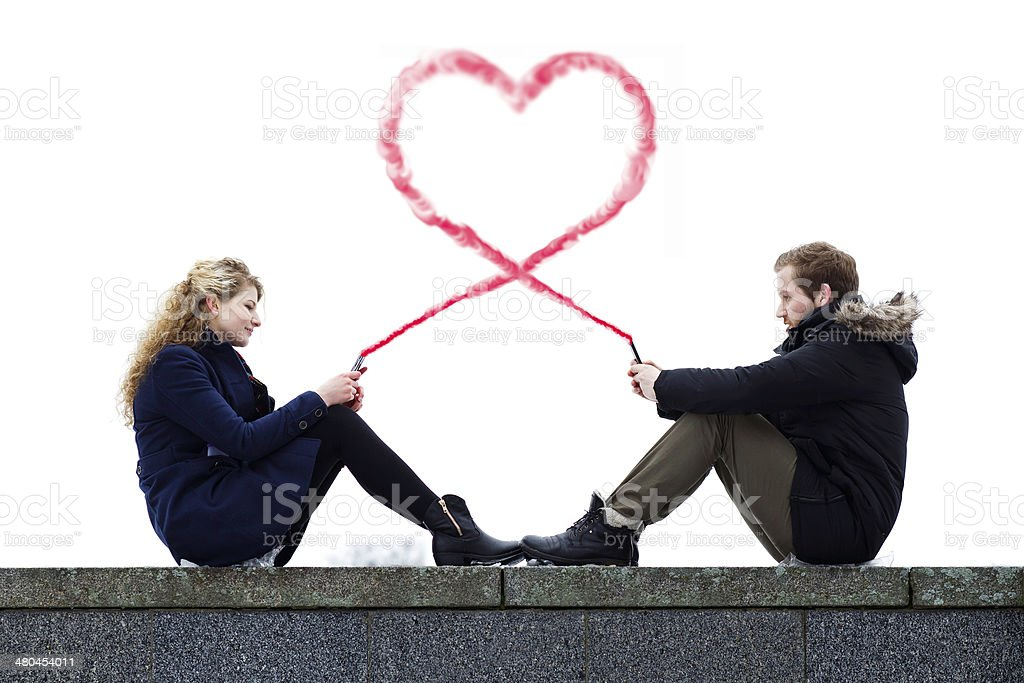 Concept of lovers communication trough social network stock photo