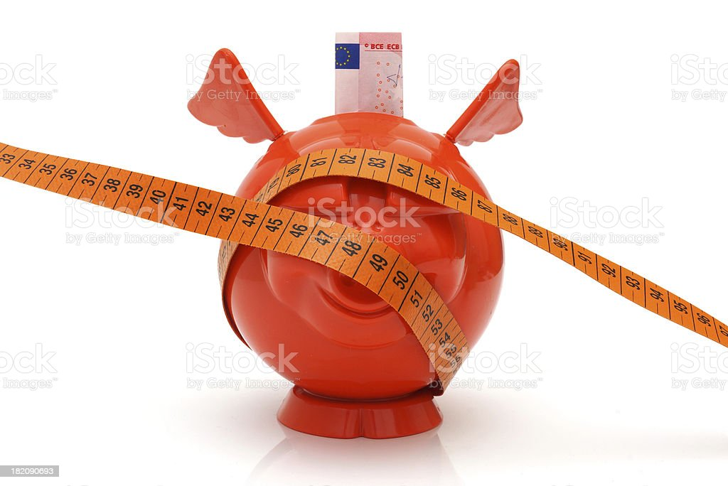 concept of no money with piggy bank and measuring tape stock photo