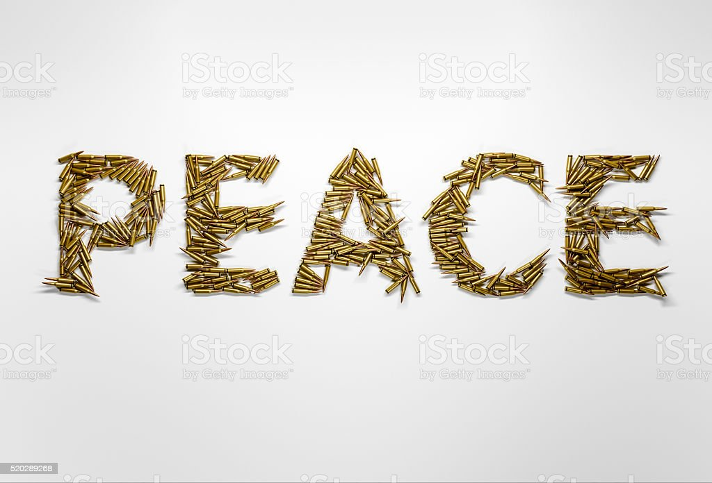 Concept of peace. Peace typed with font made of bullets stock photo