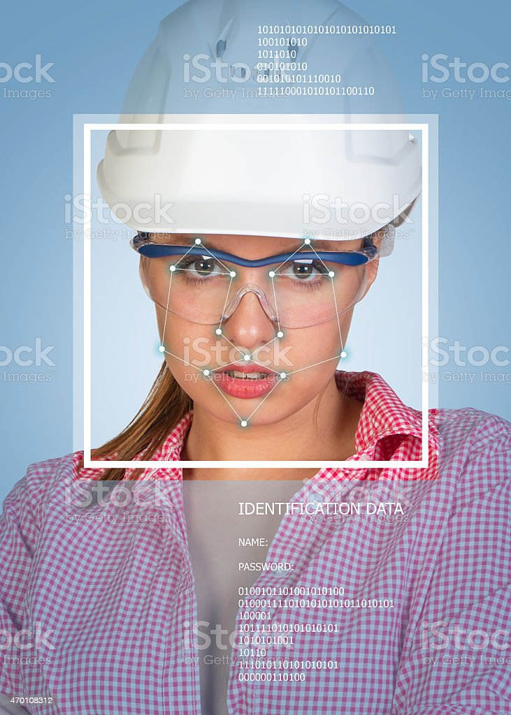Concept of person identification. Sexy builder in helmet and glasses stock photo