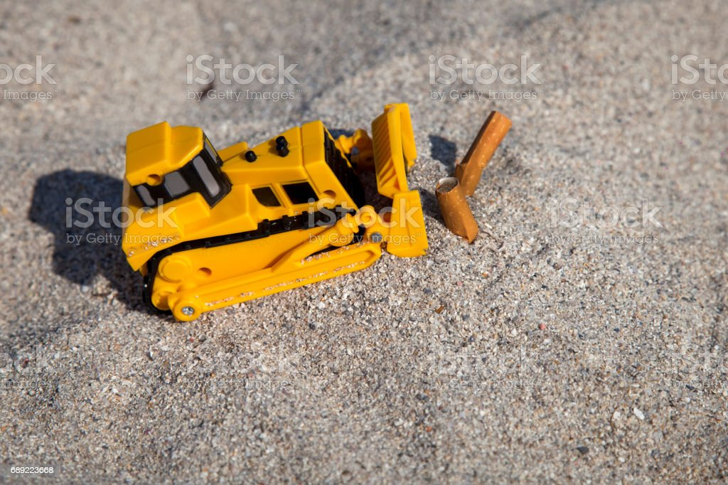 Concept of quitting smoking. Bury the cigarette butt in the sand. Throw away cigarettes. Smoking kills. stock photo