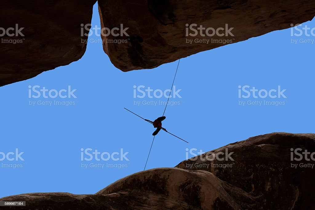 Concept of risk taking man balancing on the rope stock photo