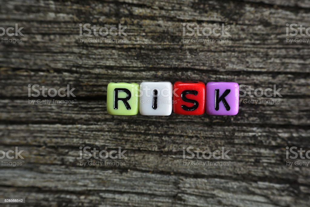 concept of risk word on wooden background stock photo