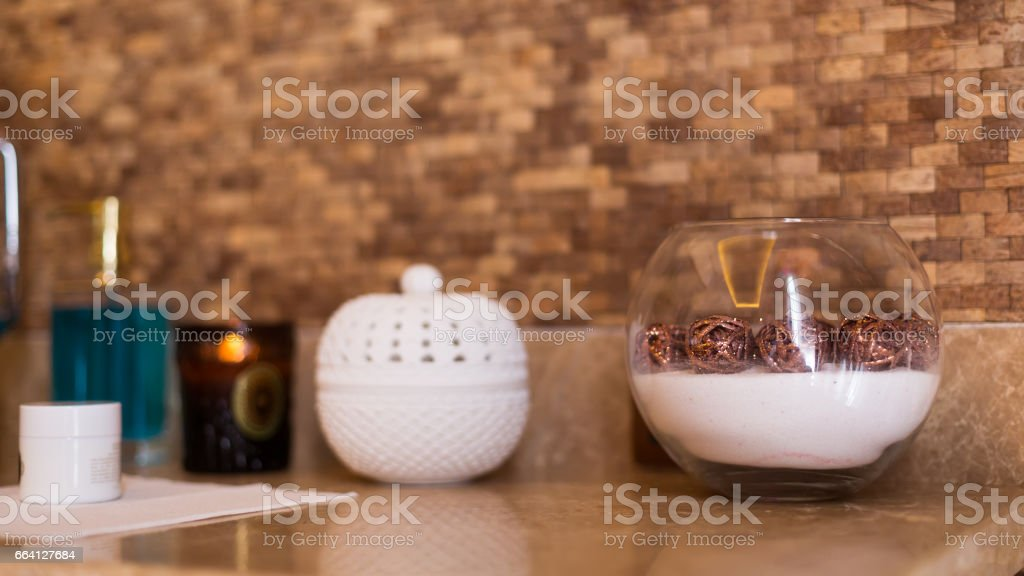 Concept of spa essentials. Lotion, box, decorative vase. Spa interior stock photo