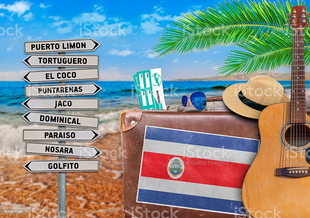 Concept of summer traveling with old suitcase and Costa Rica stock photo