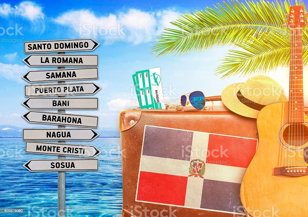 Concept of summer traveling with old suitcase and Dominican Republic stock photo