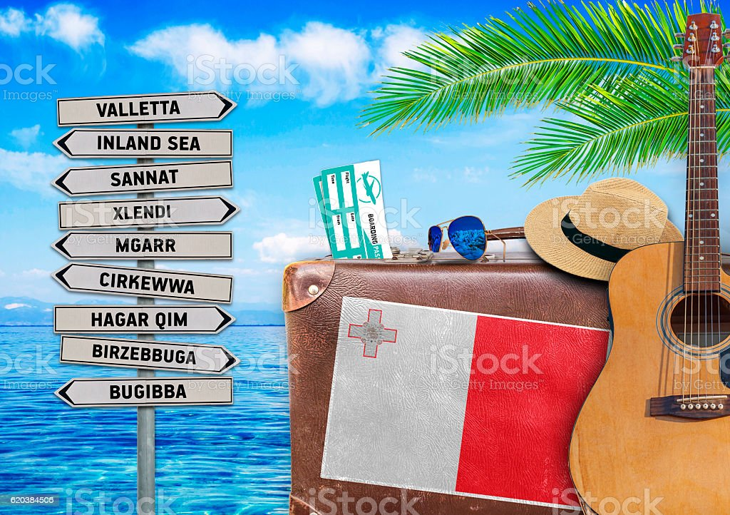 Concept of summer traveling with old suitcase and Malta town stock photo