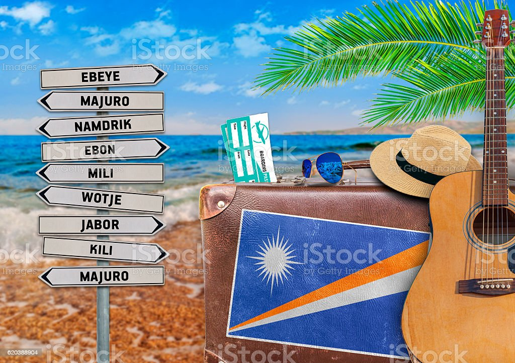 Concept of summer traveling with old suitcase and Marshall islands stock photo