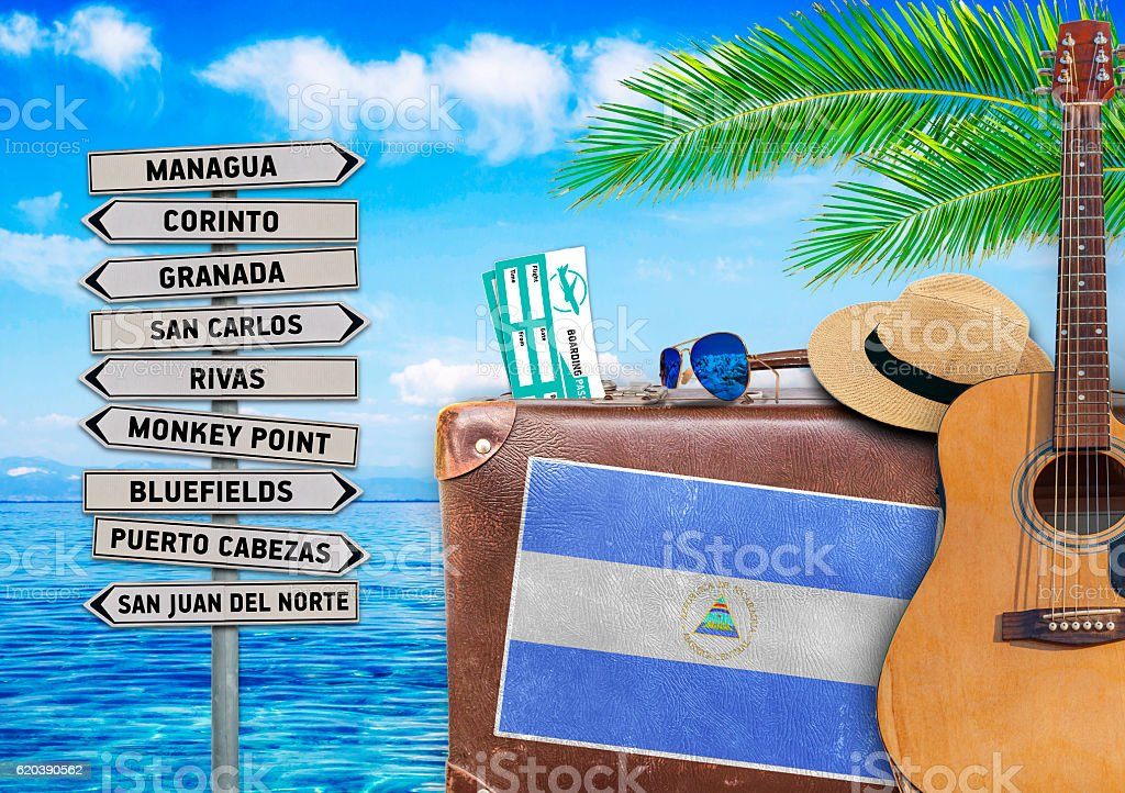 Concept of summer traveling with old suitcase and Nicaragua town stock photo
