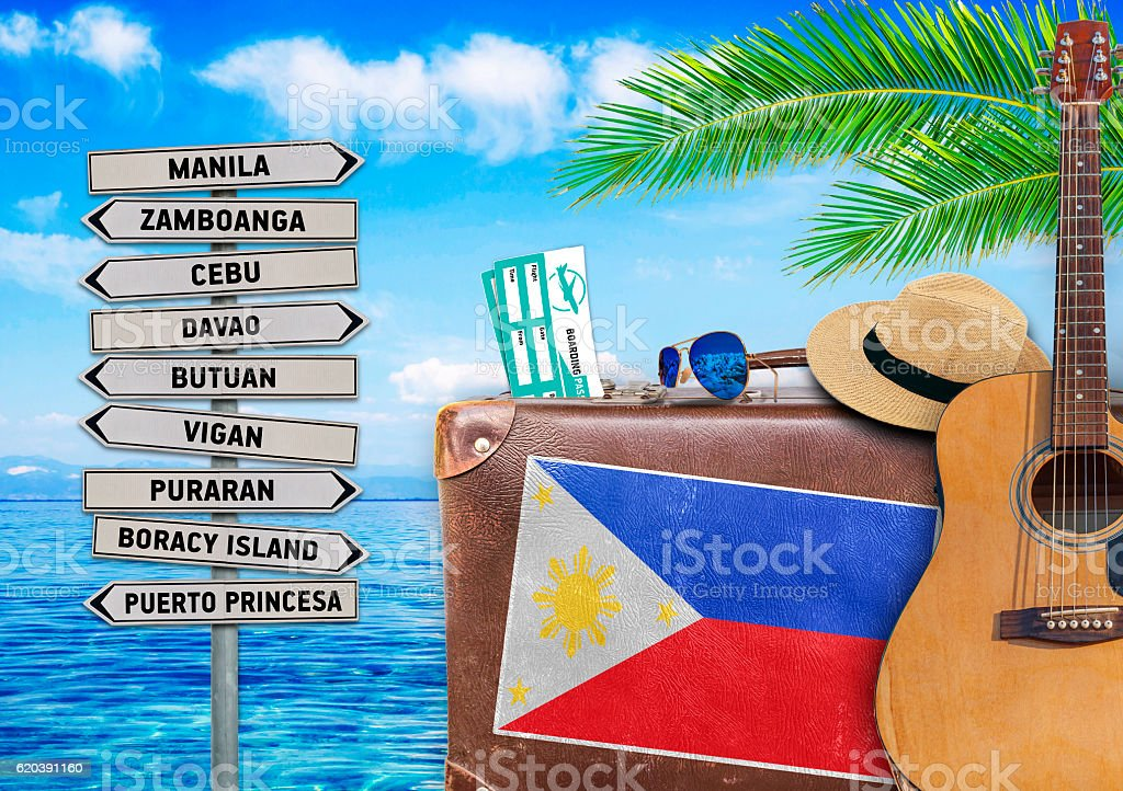 Concept of summer traveling with old suitcase and Philippines town stock photo