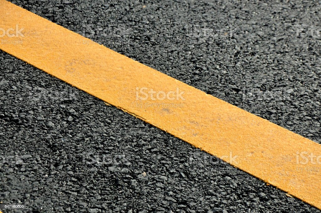 Concept of the transportation. Textural solid line on the asphalt road surface. stock photo