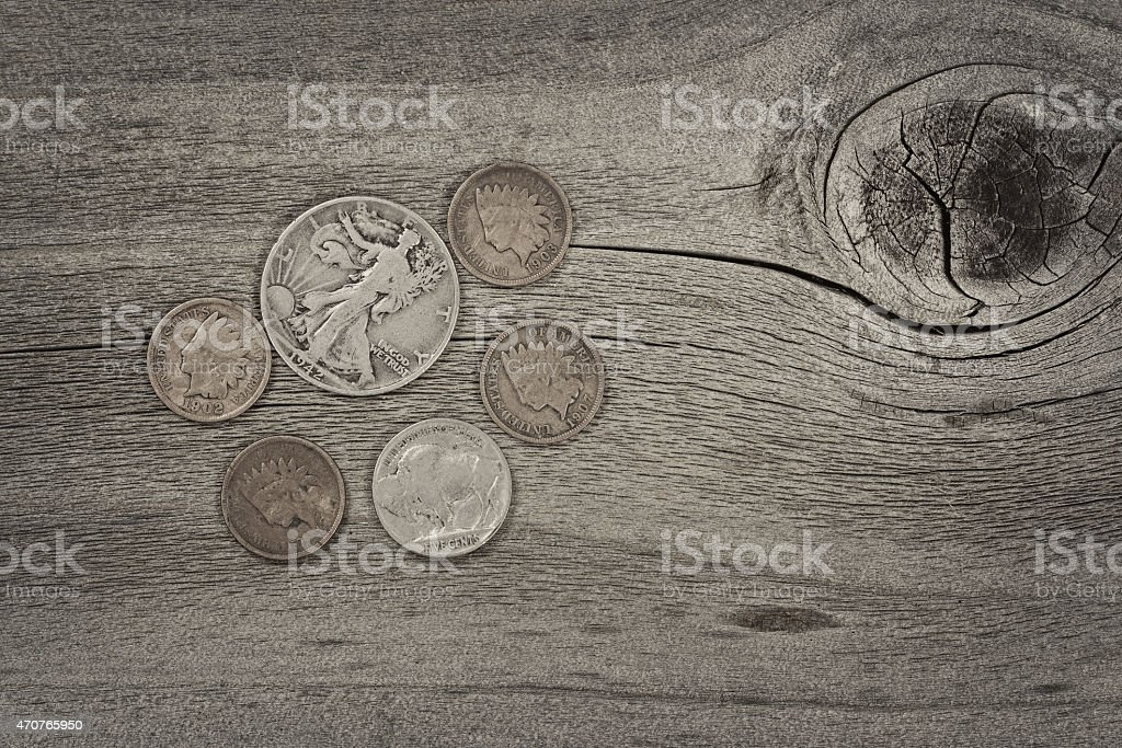 Concept of vintage coins on aged wood stock photo