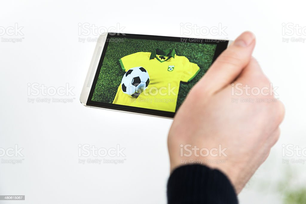 Concept of watching football from Brazil on smart phone royalty-free stock photo