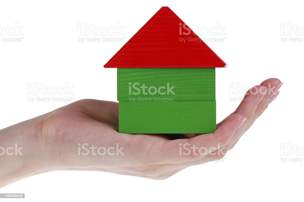 concept of wooden boxes house in woman's hand royalty-free stock photo