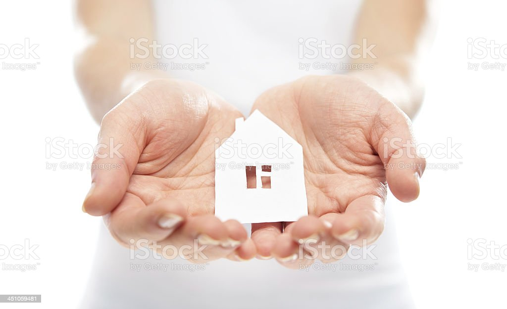 concept. paper figurine house in hands royalty-free stock photo
