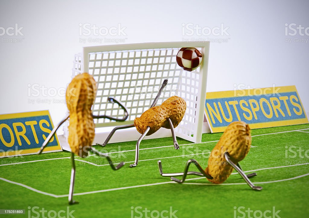 Concept peanutmen - Football goal stock photo