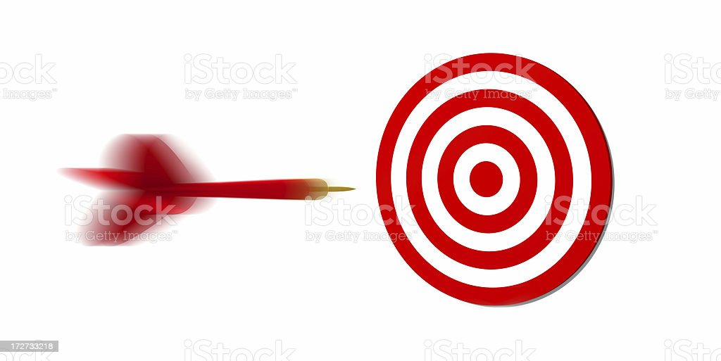 Concept photo of a red dart flying toward a target royalty-free stock photo
