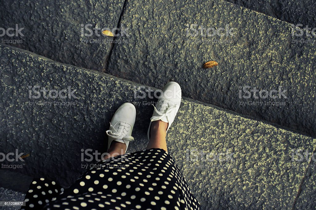 Concept picture of legs walking, vintage toned color image. Self stock photo