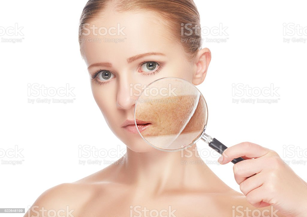 concept skincare. Skin of beauty young woman with magnifier stock photo