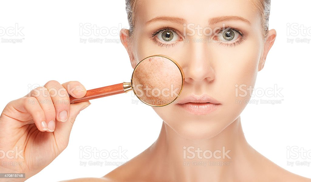 concept skincare. Skin of woman with magnifier before and after stock photo