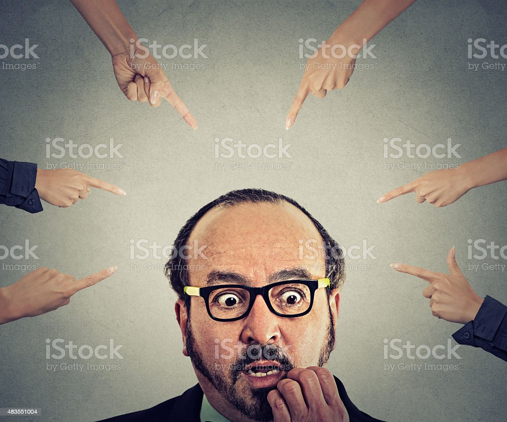 Concept social accusation of guilty businessman fingers pointing at him stock photo