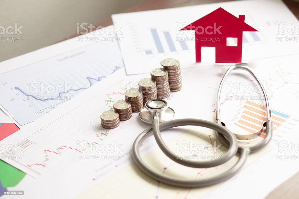 concept stethoscope car graph and coin stock photo