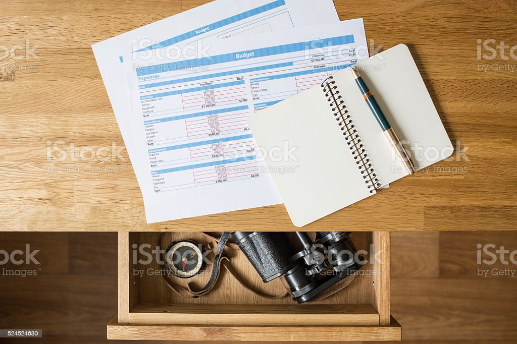 Concept travel dreams at workplace desktop stock photo