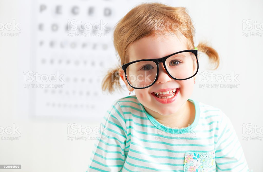 concept vision testing. child  girl with eyeglasses stock photo