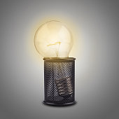 Concept with a bright light bulb in a pencil holder