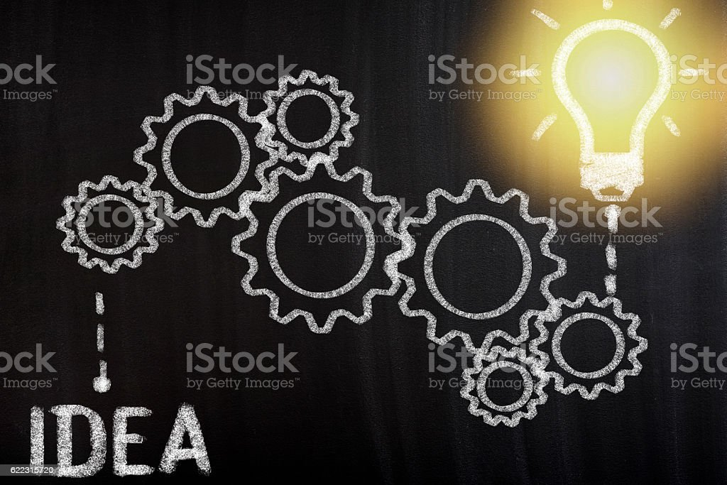Concept with abstract gear wheels and light bulb stock photo