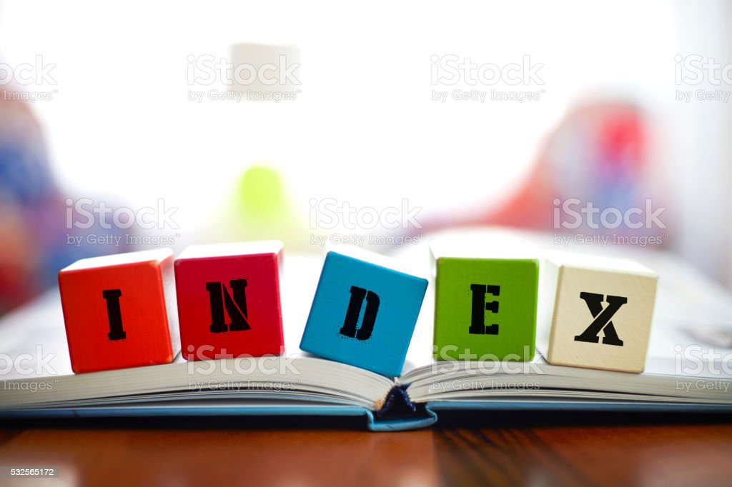 INDEX Concept with building blocks on book stock photo