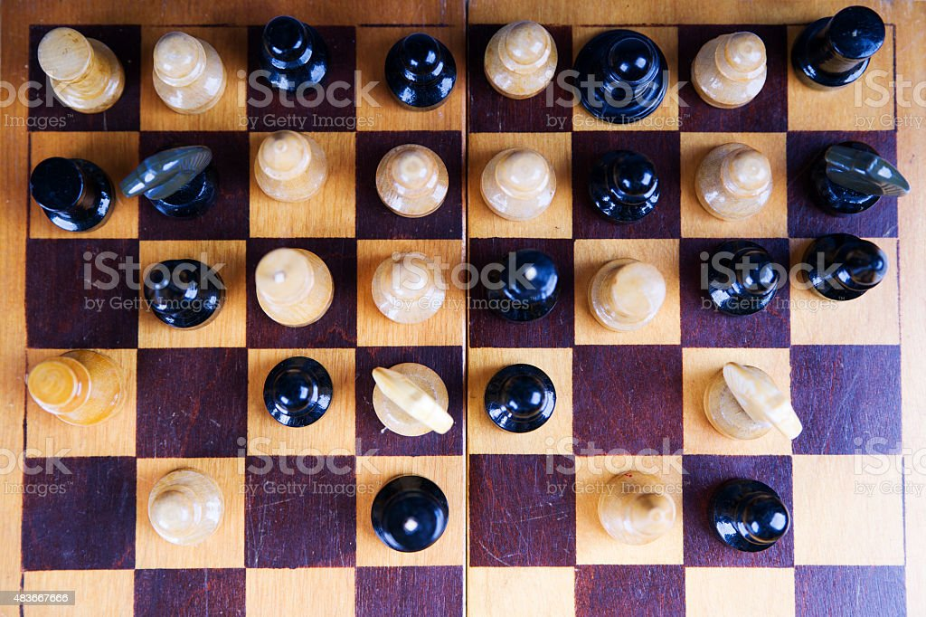 Concept with chess pieces on a wooden chess board stock photo