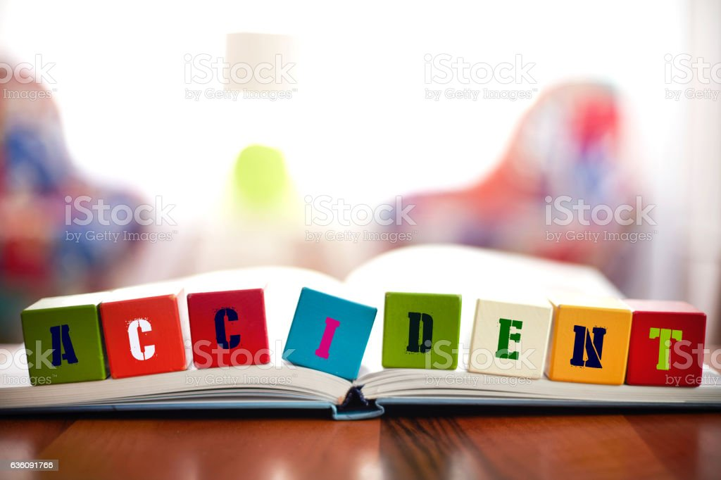 ACCIDENT Concept with eight building blocks on book stock photo