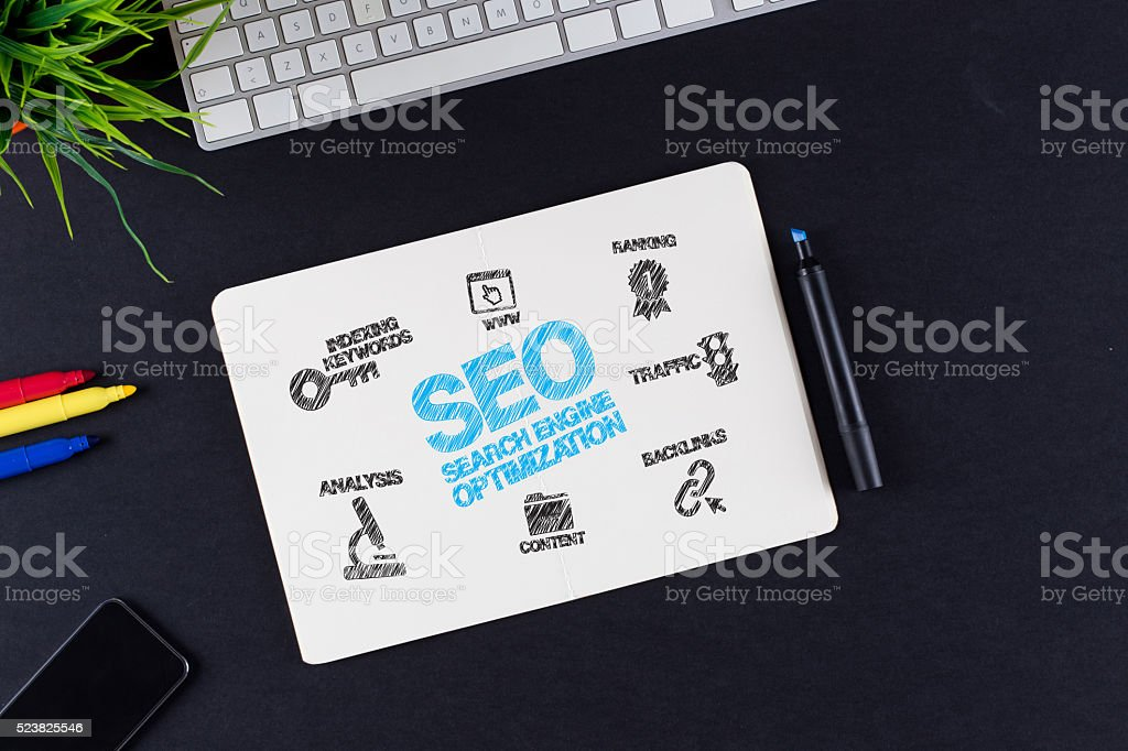 SEO Concept with Icons on Note pad stock photo