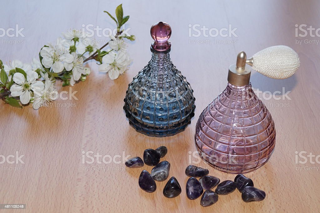 SPA concept with perfume bottle,ametist and spring flowers stock photo