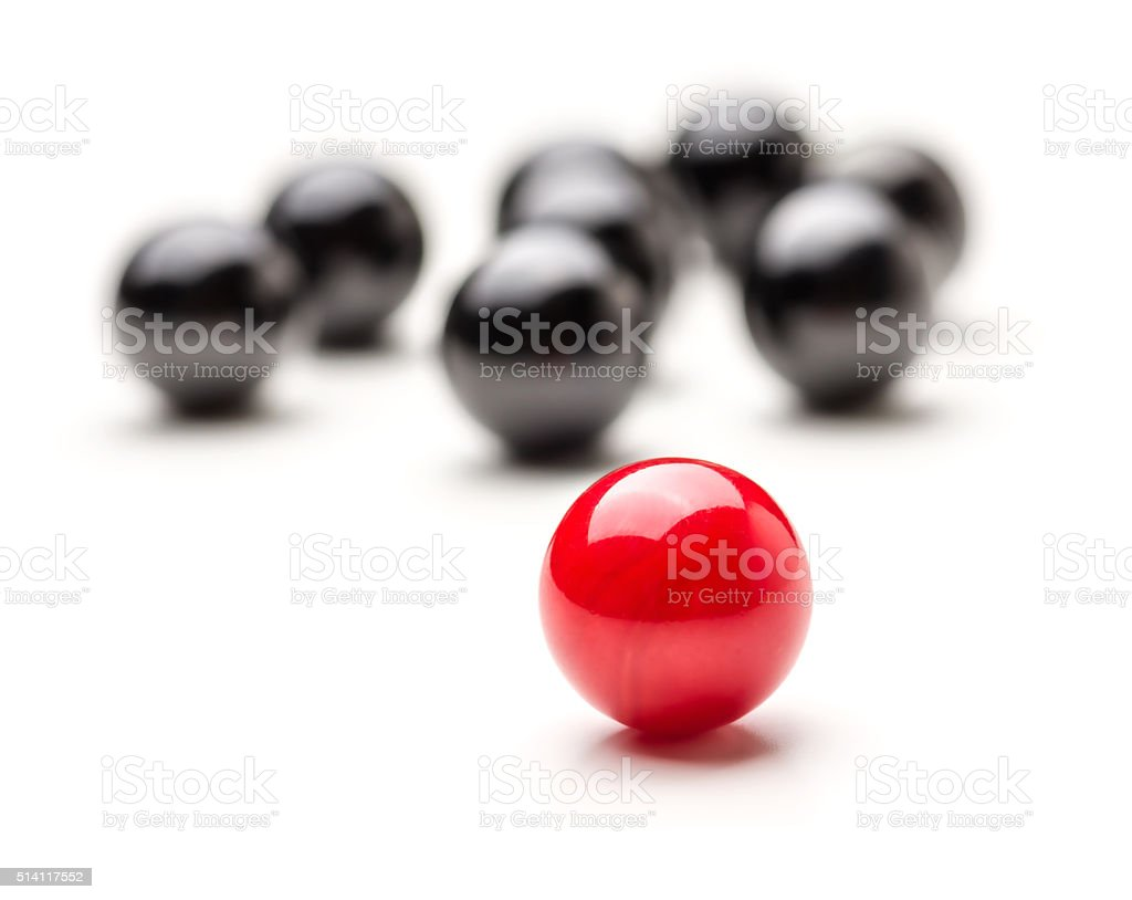 Concept with red and black marbles - Teamleader stock photo