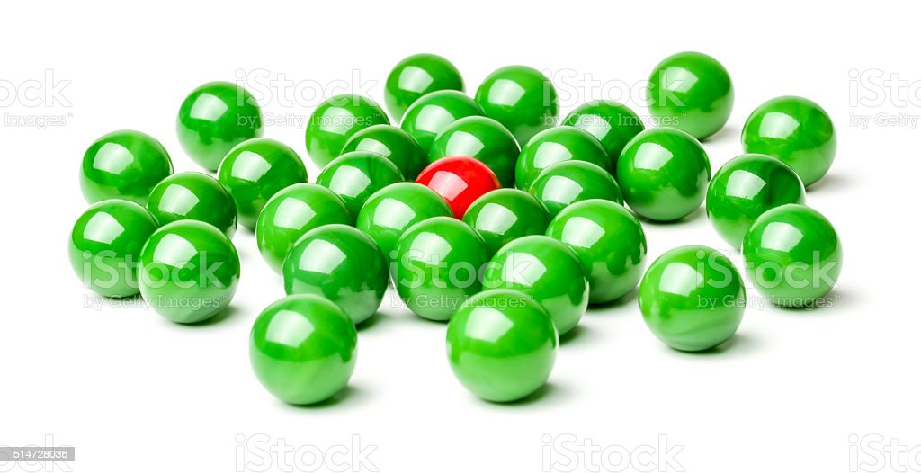 Concept with red and green marbles -  Harassment stock photo