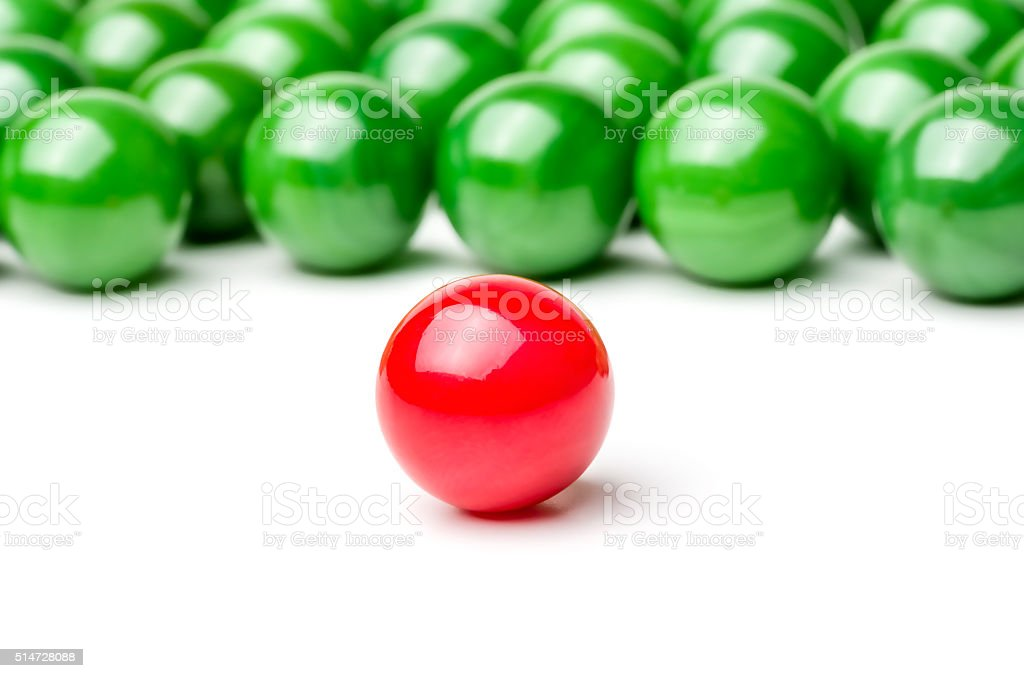 Concept with red and green marbles -  Leader stock photo