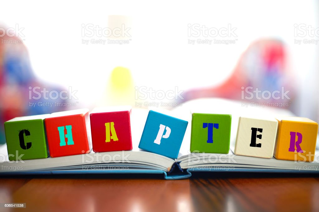 CHAPTER Concept with seven building blocks on book stock photo